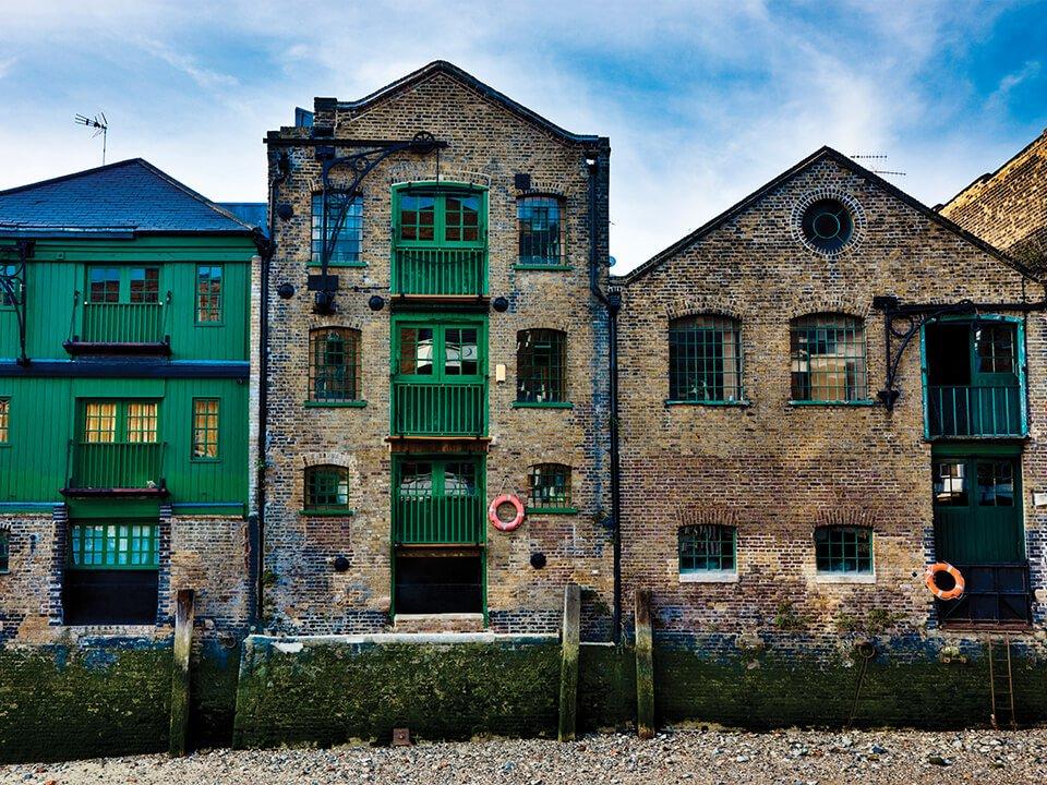 Historic warehouse on river bank